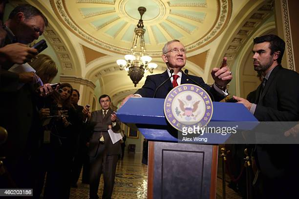S Senate Majority Leader Sen Harry Reid speaks to members of the media after the Senate Democratic Policy Luncheon at the Capitol December 9 2014 on...