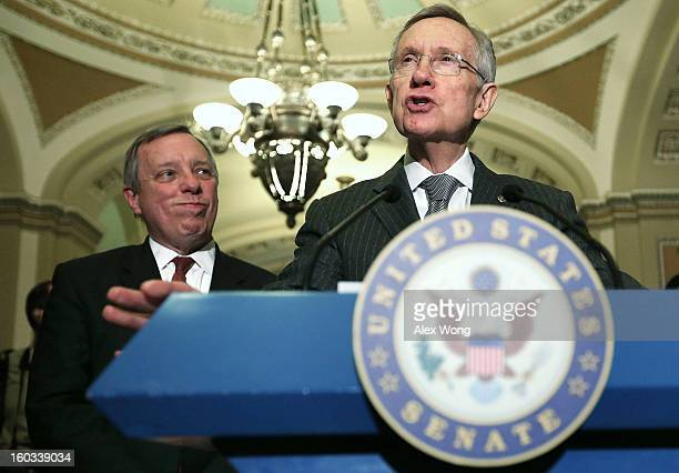 S Senate Majority Leader Sen Harry Reid speaks to members of the press as Senate Majority Whip Sen Richard Durbin looks on after the weekly Senate...
