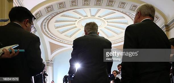 S Senate Majority Leader Sen Harry Reid speaks to members of the press as Senate Majority Whip Sen Richard Durbin looks on after the weekly Senate...