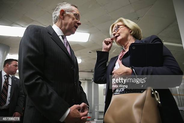 S Senate Majority Leader Sen Harry Reid talks to Sen Claire McCaskill as they wait for the Senate subway after a vote December 17 2013 on Capitol...