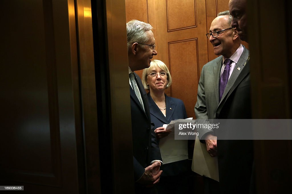 U.S. Senate Majority Leader Sen. <a gi-track='captionPersonalityLinkClicked' href=/galleries/search?phrase=Harry+Reid+-+Politician&family=editorial&specificpeople=203136 ng-click='$event.stopPropagation()'>Harry Reid</a> (D-NV) (L), U.S. Sen. <a gi-track='captionPersonalityLinkClicked' href=/galleries/search?phrase=Charles+Schumer&family=editorial&specificpeople=171249 ng-click='$event.stopPropagation()'>Charles Schumer</a> (D-NY) (R) and U.S. Sen. <a gi-track='captionPersonalityLinkClicked' href=/galleries/search?phrase=Patty+Murray&family=editorial&specificpeople=532963 ng-click='$event.stopPropagation()'>Patty Murray</a> (D-WA) (2nd L) chat in the elevator while they are on their to attend a news conference May 23, 2013 on Capitol Hill in Washington, DC. The Senate Democratic leadership held a news conference to highlight the continued obstruction by Senate Republicans of President Obama's executive and judicial nominees.