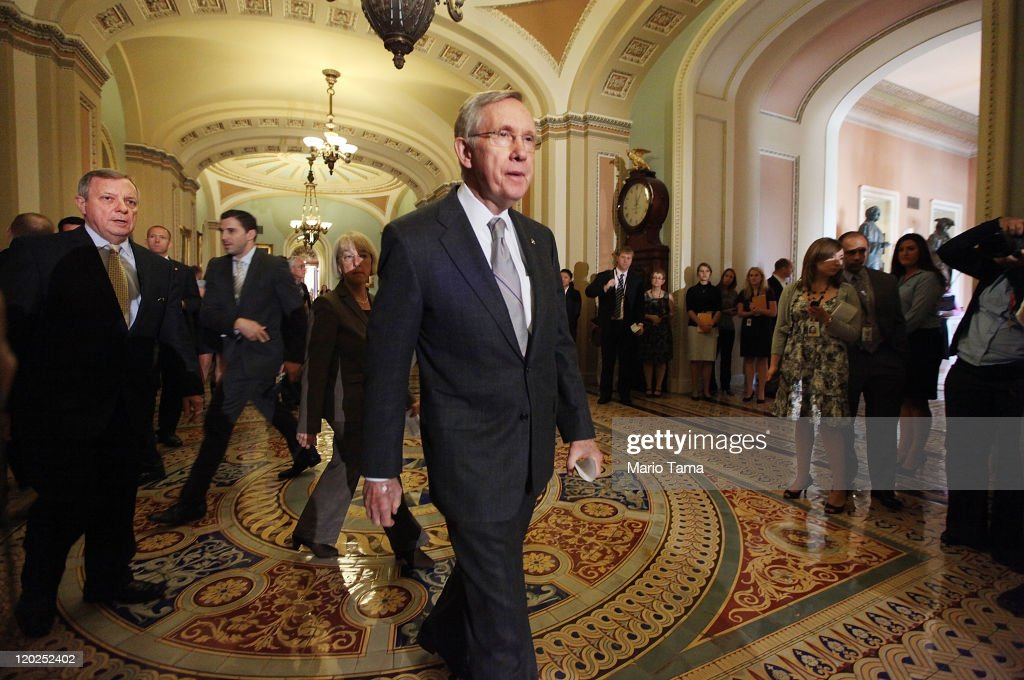 Senate Majority Leader Sen. <a gi-track='captionPersonalityLinkClicked' href=/galleries/search?phrase=Harry+Reid+-+Pol%C3%ADtico&family=editorial&specificpeople=203136 ng-click='$event.stopPropagation()'>Harry Reid</a> (D-NV) (C) walks to address the media after voting on the debt limit bill with U.S. Sen. Richard Durbin (D-IL) (L) and U.S. Sen. Patty Murray (2nd L) (D-WA) on August 2, 2011 in Washington, DC. The Senate voted 74-26 to approve the bill to raise the debt ceiling, allowing the U.S. to avoid default on its debts.