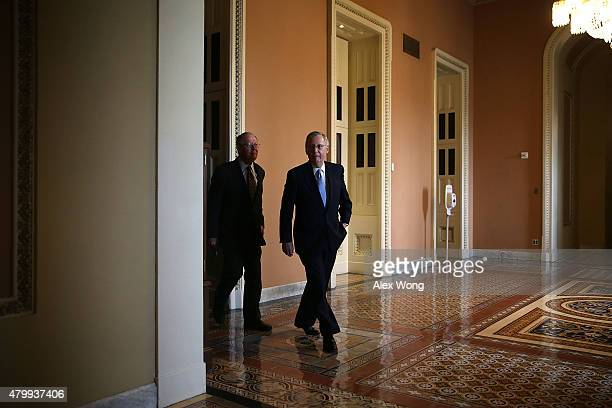 S Senate Majority Leader Sen Mitch McConnell and Sen Lamar Alexander come out after the weekly Republican Policy Luncheon July 8 2015 at the US...