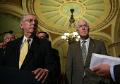 S Senate Majority Leader Sen Mitch McConnell and Senate Majority Whip Sen John Cornyn listen during a media briefing after the weekly Senate...