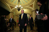 S Senate Majority Leader Sen Mitch McConnell approaches the podium for a media briefing after the weekly Senate Republican Policy Luncheon September...