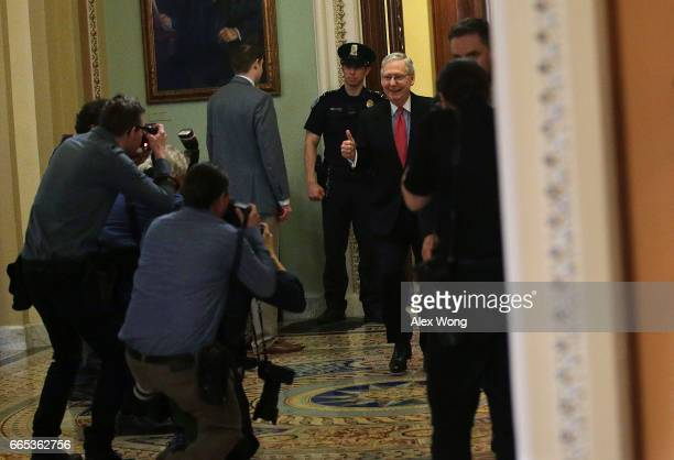 S Senate Majority Leader Sen Mitch McConnell holds a thumbs up as he comes out from the Senate Chamber at the Capitol April 6 2017 in Washington DC...