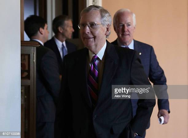 S Senate Majority Leader Sen Mitch McConnell Senate Majority Whip Sen John Cornyn and Sen John Thune come out from the Senate Republican weekly...