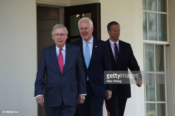 S Senate Majority Leader Sen Mitch McConnell Senate Majority Whip Sen John Cornyn and Sen John Thune leave the West Wing of the White House to speak...