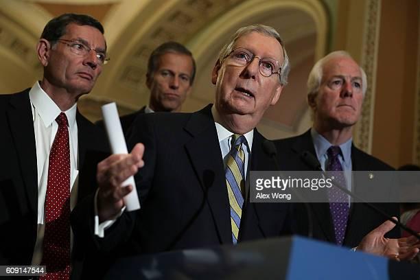 S Senate Majority Leader Sen Mitch McConnell speaks as Sen John Barrasso Sen John Thune and Senate Majority Whip Sen John Cornyn listen during a news...