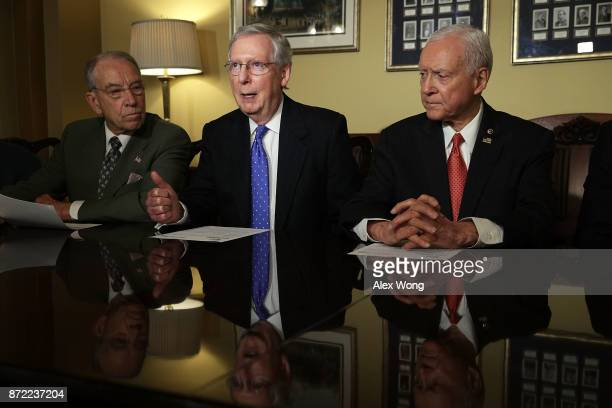 S Senate Majority Leader Sen Mitch McConnell speaks as Senate Finance Committee Chairman Sen Orrin Hatch and Sen Chuck Grassley listen during a...