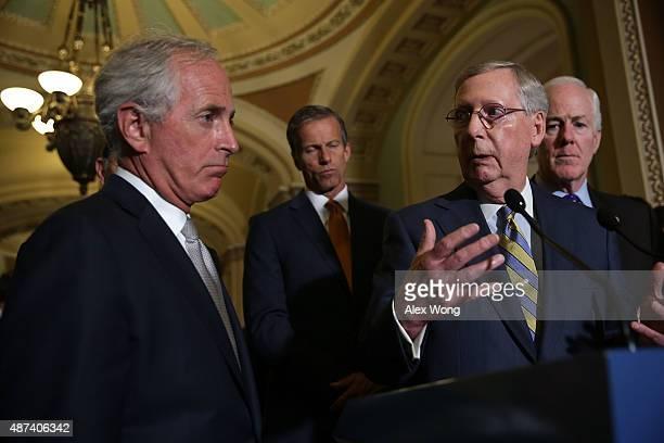 S Senate Majority Leader Sen Mitch McConnell speaks to members of the media as Sen Bob Corker Sen John Thune and Senate Majority Whip Sen John Cornyn...