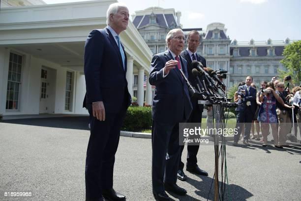 S Senate Majority Leader Sen Mitch McConnell speaks to members of the media as Senate Majority Whip Sen John Cornyn and Sen John Thune look on...