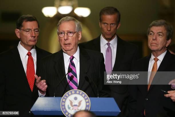 S Senate Majority Leader Sen Mitch McConnell speaks to members of the media at the Capitol as Sen John Barrasso Sen John Thune and Sen Roy Blunt...