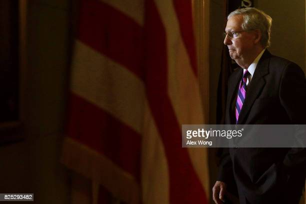 S Senate Majority Leader Sen Mitch McConnell walks back to his office after he speaking to members of the media at the Capitol August 1 2017 in...