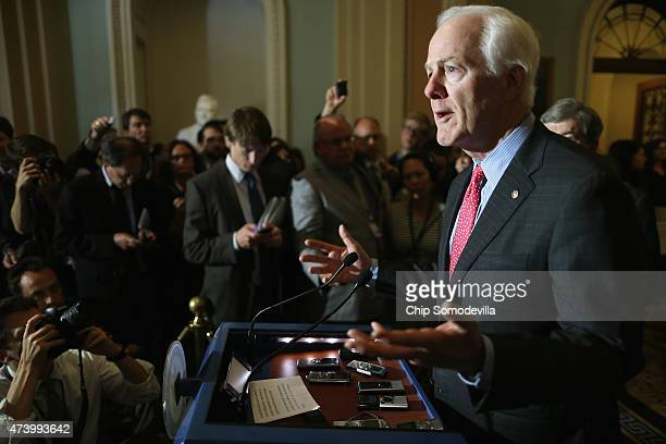 Senate Majority Whip John Cornyn talks to reporters after the weekly Senate GOP policy luncheon at the US Capitol May 19 2015 in Washington DC...
