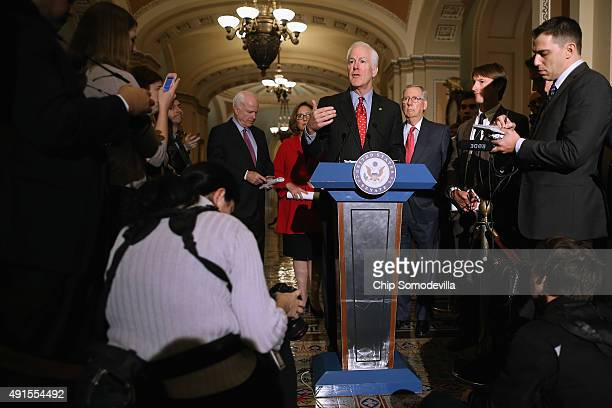 Senate Majority Whip John Cornyn talks to reporters after the weekly Republican policy luncheon at the US Capitol October 6 2015 in Washington DC...