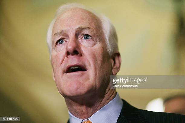 Senate Majority Whip John Cornyn talks to reporters following the weekly Senate GOP policy luncheon at the US Capitol December 15 2015 in Washington...