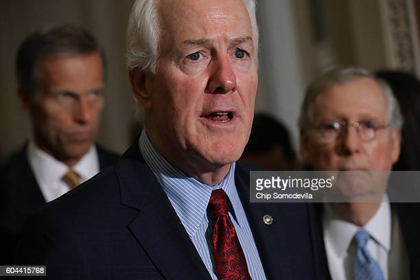 Senate Majority Whip John Cornyn talks to reporters with Sen John Thune and Senate Majority Leader Mitch McConnell following the weekly Senate...