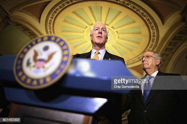 Senate Majority Whip John Cornyn talks to reporters with Senate Majority Leader Mitch McConnell following the weekly Senate GOP policy luncheon at...