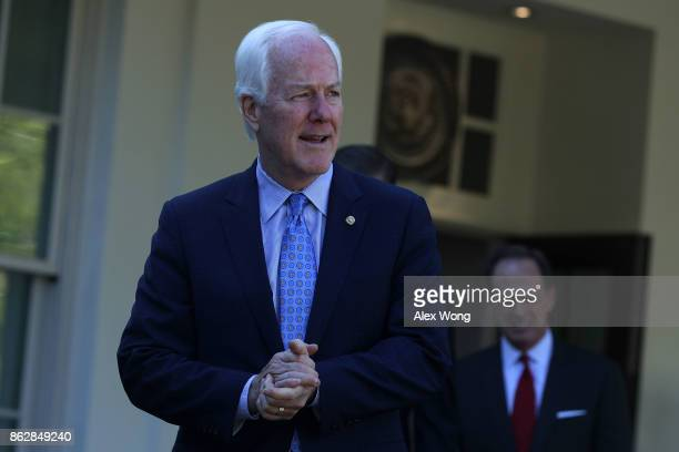 S Senate Majority Whip Sen John Cornyn comes out from the West Wing of the White House after a meeting with President Donald Trump October 18 2017 in...