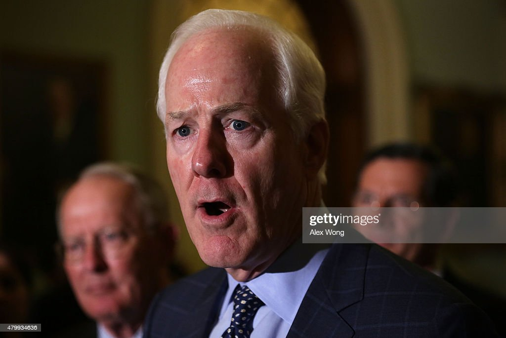 S Senate Majority Whip Sen John Cornyn speaks as Sen Lamar Alexander and Sen John Barrasso listen during a news briefing July 8 2015 at the US...