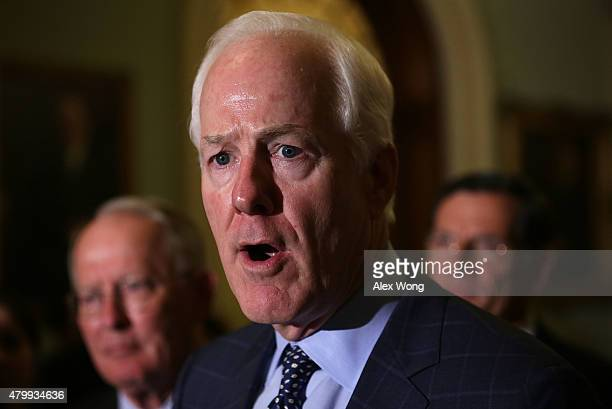 S Senate Majority Whip Sen John Cornyn speaks as Sen Lamar Alexander and Sen John Barrasso listen during a news briefing July 8 2015 at the US...