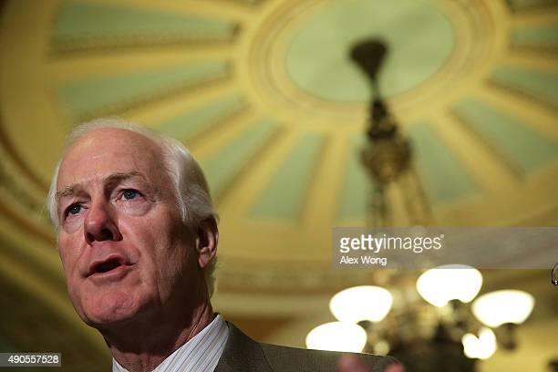 S Senate Majority Whip Sen John Cornyn speaks during a media briefing after the weekly Senate Republican Policy Luncheon September 29 2015 at the US...
