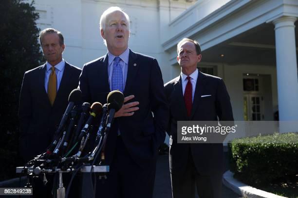 S Senate Majority Whip Sen John Cornyn speaks to members of the media as Sen John Thune and Sen Pat Toomey listen outside the West Wing of the White...