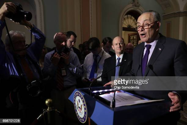 Senate Minority Leader Charles Schumer and Sen Chris Coons talks to reporters following the weekly Democratic policy luncheon at the US Capitol June...