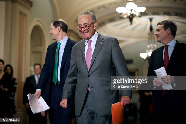 Senate Minority Leader Charles Schumer is joined by Sen Ron Wyden and Sen Michael Bennet for a news conference following the Senate Democratic policy...