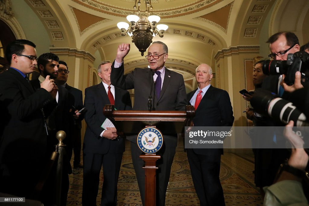 Senate Minority Leader Charles Schumer (D-NY) (C) is joined by Senate Minority Whip Dick Durbin (D-IL) (L) and Sen. Ben Cardin (D-MD) while talking to reporters following the weekly Democratic Policy Committee luncheon in the U.S. Capitol November 28, 2017 in Washington, DC. Citing an inflamitory Tweet by President Donald Trump, Schumer and House Minority Leader Nancy Pelosi (D-CA) cancelled their meeting with Trump and Republican congressional leaders scheduled for later in the day.
