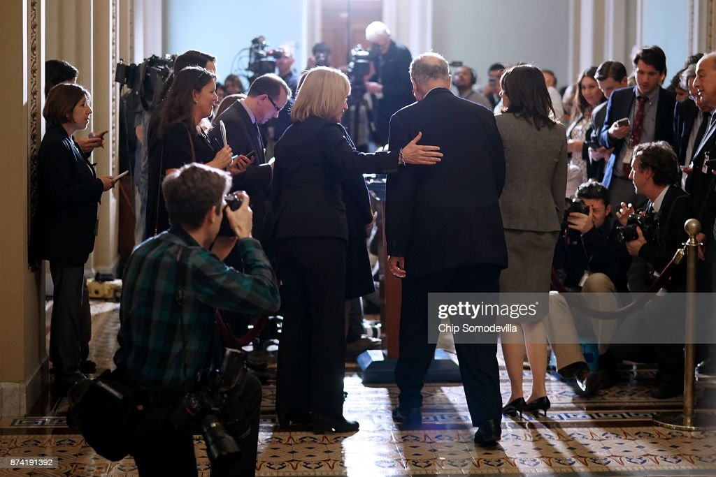 Senate Minority Leader Charles Schumer (D-NY) (C), Sen. Maria Cantwell (D-WA), Sen. Maggie Hassan (D-NH) and Sen. Amy Klobuchar (D-MN) talk to reporters following the weekly Senate Democratic policy luncheon in the U.S. Capitol November 14, 2017 in Washington, DC. Senate Republicans are considering including a repeal of the Obamacare individual mandate as part of their proposed tax cut and reform legislation, which they want to pass the week after the Thanksgiving holiday.