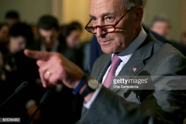Senate Minority Leader Charles Schumer talks with reporters following the Senate Democratic policy luncheon at the US Capitol August 1 2017 in...