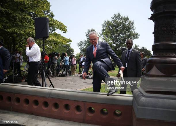 Senate Minority Leader Charles Schumer walks away after unveiling 'A Better Deal On Trade and Jobs' in front of the US Capitol on August 2 2017 in...