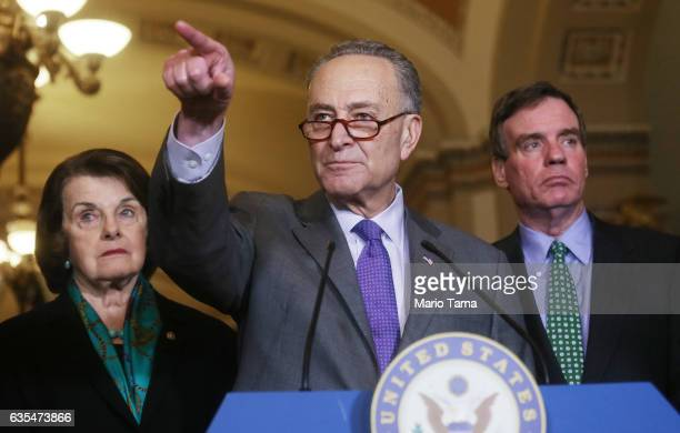 Senate Minority Leader Chuck Schumer points to a reporter as Sen Mark Warner vice chair of the Intelligence Committee and Sen Dianne Feinstein...