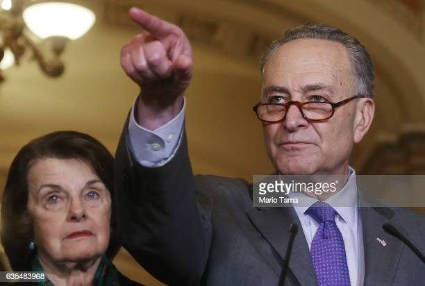 Senate Minority Leader Chuck Schumer points to a reporter as Sen Dianne Feinstein ranking member of the Senate Judiciary Committee looks on at a...