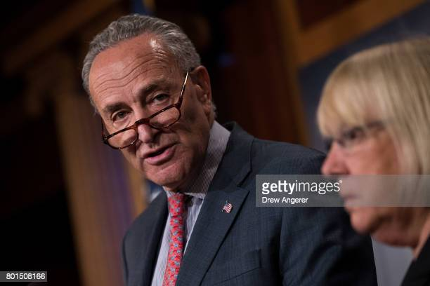Senate Minority Leader Chuck Schumer speaks as Sen Patty Murray looks on during a press conference about the Senate Republican health care bill on...