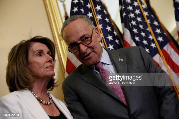 Senate Minority Leader Chuck Schumer speaks with House Minority Leader Nancy Pelosi at a news conference about the Child Care for Working Families...