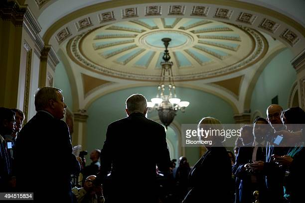 Senate Minority Leader Harry Reid a Democrat from Nevada center speaks during a news conference after a Democratic Senate luncheon at the US Capitol...