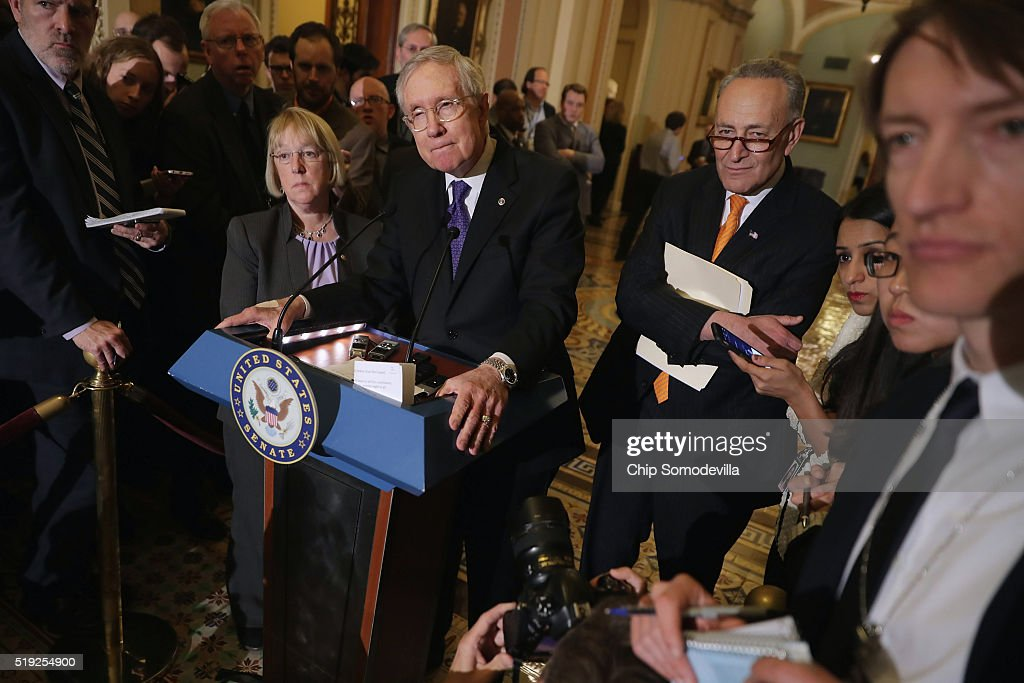 Senate Minority Leader <a gi-track='captionPersonalityLinkClicked' href=/galleries/search?phrase=Harry+Reid+-+Politician&family=editorial&specificpeople=203136 ng-click='$event.stopPropagation()'>Harry Reid</a> (D-NV) (3rd L) and fellow Democratic senators (L-R0 Sen. <a gi-track='captionPersonalityLinkClicked' href=/galleries/search?phrase=Patty+Murray&family=editorial&specificpeople=532963 ng-click='$event.stopPropagation()'>Patty Murray</a> (D-WA) and Sen. <a gi-track='captionPersonalityLinkClicked' href=/galleries/search?phrase=Charles+Schumer&family=editorial&specificpeople=171249 ng-click='$event.stopPropagation()'>Charles Schumer</a> (D-NY) talk to reporters following their weekly policy luncheon at the U.S. Capitol April 5, 2016 in Washington, DC. Democrats and Republicans are looking to extend a key renewable tax break in the legislation to reauthorize the Federal Aviation Administration, slated to receive a vote later this week.