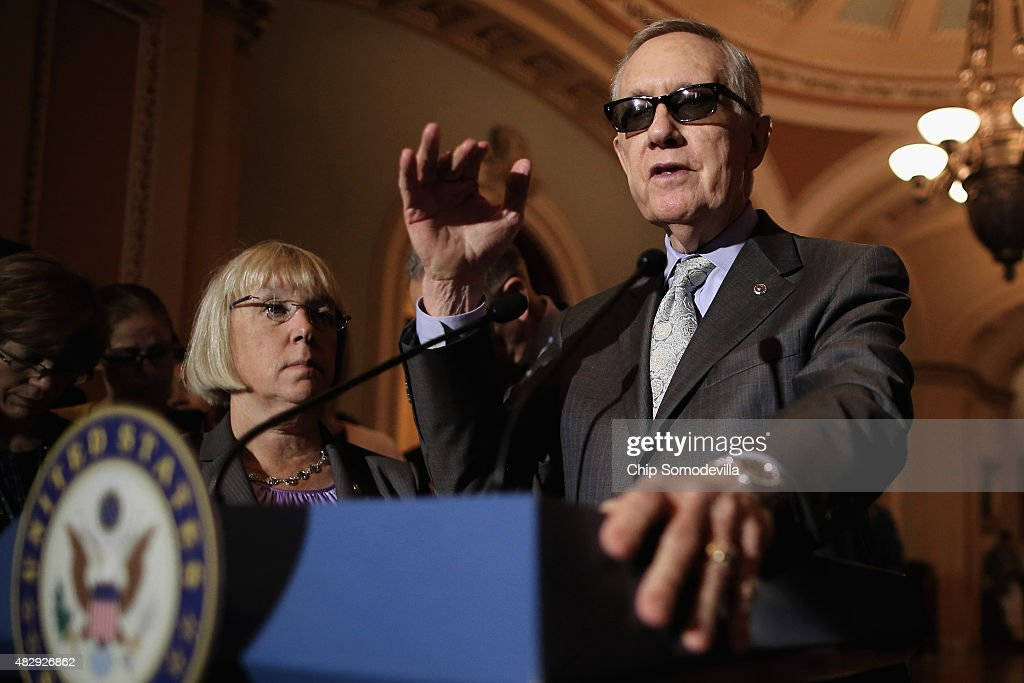 Senate Minority Leader Harry Reid (D-NV) (R) and Sen. Patty Murray (D-WA) talk with reporters after the weekly Democratic policy luncheon at the U.S. Capitol August 4, 2015 in Washington, DC. Reid said there would be enough support to move a cybersecurity bill forward if Democrats were able to offer relevant amendments.