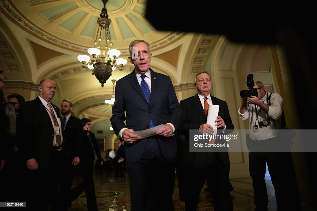 Senate Minority Leader <a gi-track='captionPersonalityLinkClicked' href=/galleries/search?phrase=Harry+Reid&family=editorial&specificpeople=203136 ng-click='$event.stopPropagation()'>Harry Reid</a> (D-NV) (C) and Senate Minority Whip Richard Durbin (D-IL) (2nd R) arrive for a news conference after the weekly Democratic Senate policy luncheon at the U.S. Capitol February 3, 2015 in Washington, DC. Reid is wearing a bandage over his right eye after undergoing surgery to repair damage from an exercise accident.