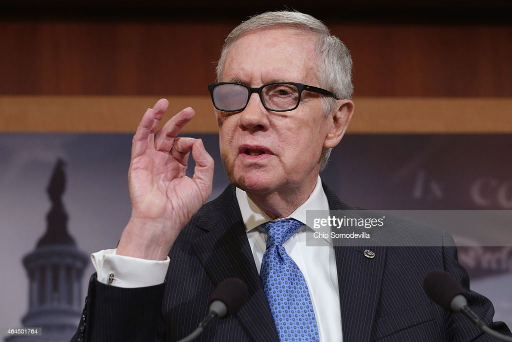 Senate Minority Leader <a gi-track='captionPersonalityLinkClicked' href=/galleries/search?phrase=Harry+Reid+-+Pol%C3%ADtico&family=editorial&specificpeople=203136 ng-click='$event.stopPropagation()'>Harry Reid</a> (D-NV) answers reports' questions during a news conference in the Radio Television Gallery at the U.S. Capitol February 26, 2015 in Washington, DC. Reid and House Minority Leader Nancy Pelosi (D-CA) were critical of the Republican leadership in the House and Senate because of the delay in funding for the Department of Homeland Security.
