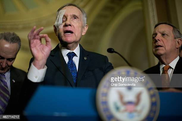 Senate Minority Leader Harry Reid is flanked by Sen Charles Schumer and Senate Minority Whip Richard Durbin while talking to reporters after the...