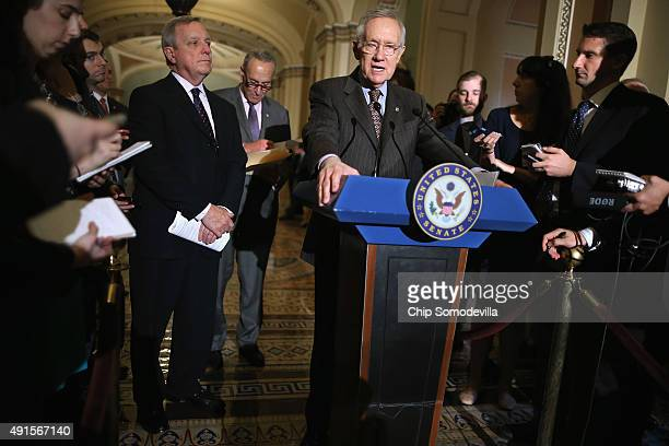 Senate Minority Leader Harry Reid joins fellow Senate Democratic leaders while talking to reporters after their weekly caucus policy luncheon at the...