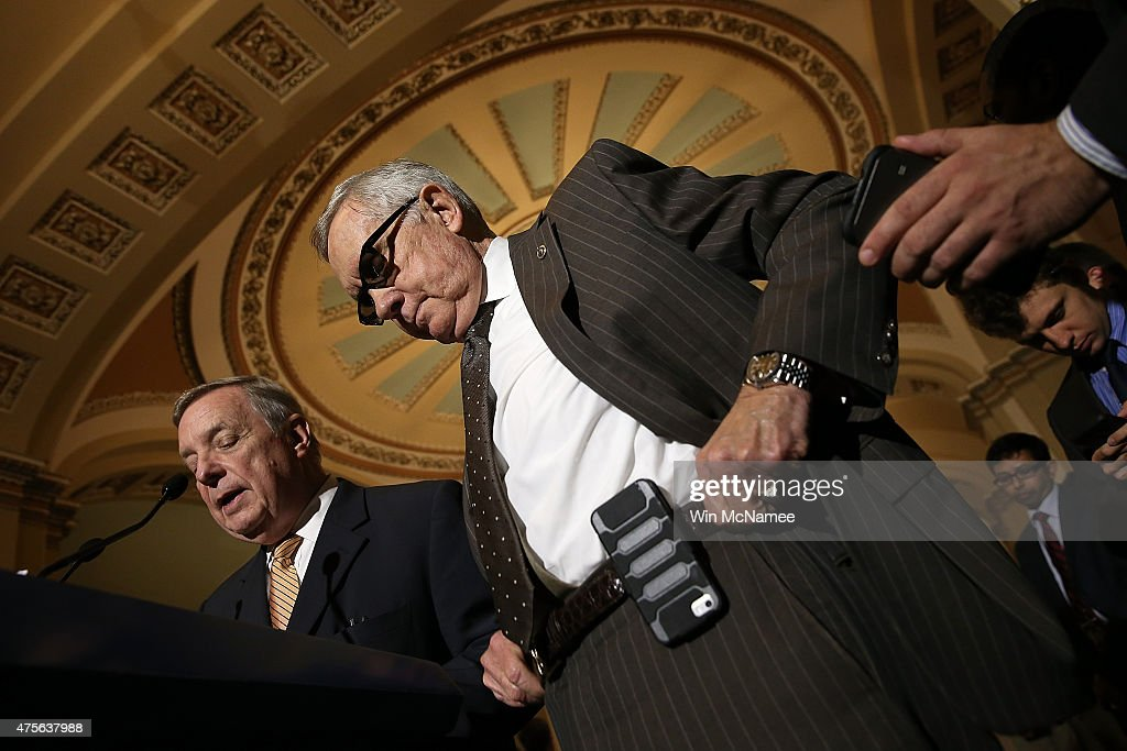 Senate Minority Leader Harry Reid listens as U.S. Sen. Dick Durbin (L) answers questions at the U.S. Capitol June 2, 2015 in Washington, DC. Reid and Democratic listens spoke following the weekly Democratic caucus policy luncheon.