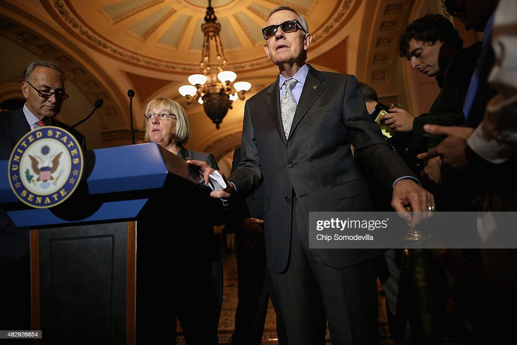Senate Minority Leader Harry Reid (D-NV) (C), Sen. Patty Murray (D-WA) (2nd L) and Sen. Charles Schumer (D-NY) (L) talk with reporters after the weekly Democratic policy luncheon at the U.S. Capitol August 4, 2015 in Washington, DC. Reid said there would be enough support to move a cybersecurity bill forward if Democrats were able to offer relevant amendments.