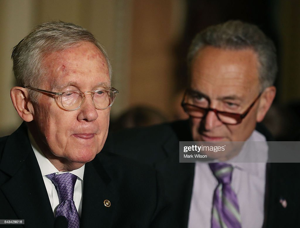 Senate Minority Leader Harry Reid (D-NV), (L), speaks to reporters while flanked by Sen. Charles Schumer (D-NY), on Capitol Hill, June 28, 2016 in Washington, DC. The Senate lawmakers addressed the press affter their weekly policy luncheons.