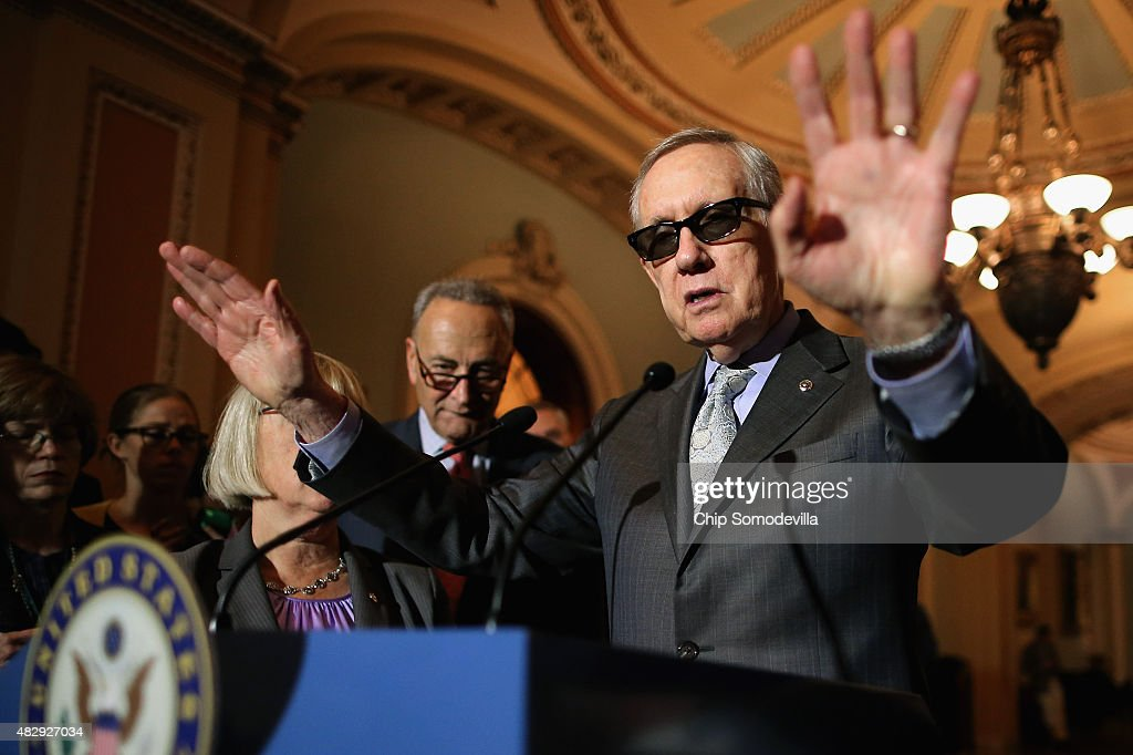 Senate Minority Leader Harry Reid (D-NV) talk with reporters with Sen. Charles Schumer (D-NY) (L) after the weekly Democratic policy luncheon at the U.S. Capitol August 4, 2015 in Washington, DC. Reid said there would be enough support to move a cybersecurity bill forward if Democrats were able to offer relevant amendments.