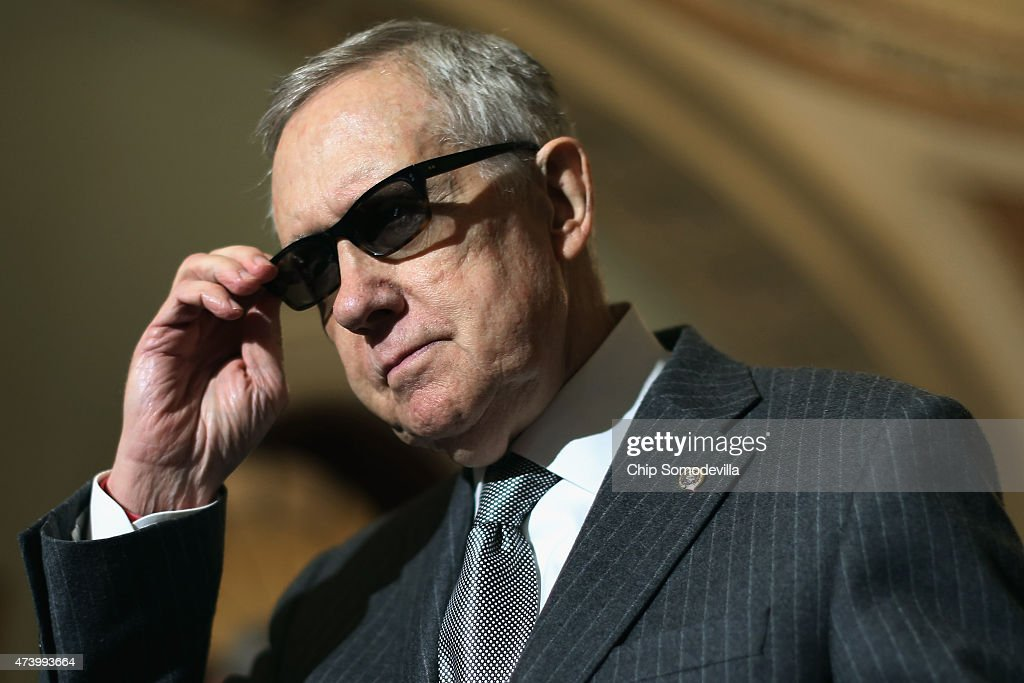 Senate Minority Leader <a gi-track='captionPersonalityLinkClicked' href=/galleries/search?phrase=Harry+Reid&family=editorial&specificpeople=203136 ng-click='$event.stopPropagation()'>Harry Reid</a> (D-NV) talks to reporters after the weekly Democratic policy luncheon at the U.S. Capitol May 19, 2015 in Washington, DC. Reid said that the Republicans in control of the Senate will take measures to limit debate on the Trade Promotion Authority bill and mive it closer to a vote this week.